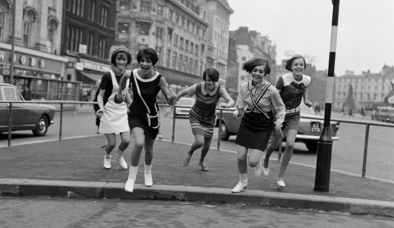 Mary Quant and her Ginger Group of girls in Market Street Manchester.  February 1966. Photo by Howard Walker - Mirrorpix Getty Images